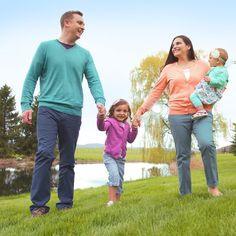 A husband and wife and their two children spend time outdoors together