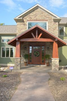 Timber front porch with stone.