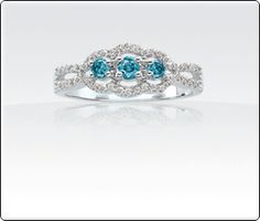 1/2ct T.W. Blue & White Diamond 3 Stone Framed White Gold Ring.... Waiting on it from my darling angel baby!