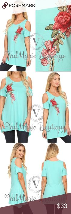 "📍CLEARANCE 📍Aqua Rose Soft Cold Shoulder Top Solid, long body top in a relaxed fit, with short sleeves, cold shoulders, a scoop neck, asymmetric hem, and floral embroidery. 95% Rayon, 5% Spandex. Fits TTS   S(2-4) M(6-8) L(10-12) XL (14) Bust laying flat- S 16"", M 17.5"", L 18"", XL 19"" - stretches bigger Length- S 28.5"", M 29.5"", L 30"", XL 30.5"" ValMarie Boutique LLC Tops"