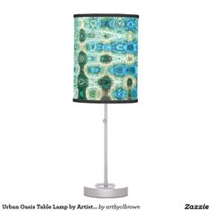 The Urban Oasis Table Lamp designed by Artist C.L. Brown features an abstract kinetic light painting design enhanced with Photoshop. Brighten up any room with this custom table lamp that will add instant style to your home decor. Choose your trim and style for a special, one-of-a kind home or office accent. Printed with state-of-the-art 14 color vibrant printing with fade resistant ink. Available in film polyester, rice paper, and linen lamp. Includes a 6' Power Cord with 2-prong USA plug…