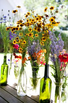 recycled wine bottles look great clustered amongst other glass (and inexpensive, too!)