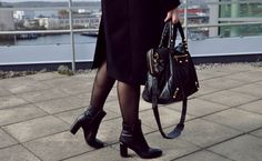 Black coat and Balenciaga velo bag. Whyred shoes