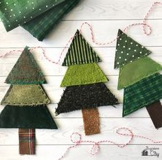 Christmas Tree Banner from Fabric Scraps! Create this beautiful and rustic Christmas tree banner using fabric scraps you already have Fabric Christmas Trees, Felt Christmas Decorations, Christmas Banners, Diy Christmas Tree, Christmas Projects, Handmade Christmas, Holiday Crafts, Christmas Ornaments, Christmas Boxes