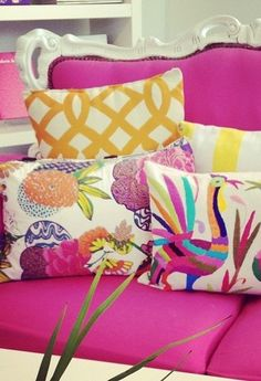 love the vivid sofa colour broken up by the coordinating collection of patterned and textured cushions