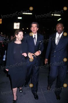 1005-George Magazine's We the People Series at Alfred Dunhill Store, New York City. John F Kennedy Jr and his assistant RoseMarie Terenzio