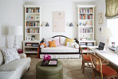 The bed in this studio space from Domino isn't really separated from the rest of the apartment — but the flanking bookcases give it a little extra coziness, which is always nice to have in your 'bedroom', even in a little bitty apartment.