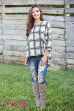 We love this trendy twist on a classic plaid blouse - it's perfect for transitioning between seasons in style! Featuring a scoopneck, a dramatic high low cut, roll up 3/4 sleeves, and a lightweight, soft material, it's so easy to rock with jeans or jeggings all season long!