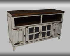 Color: Antique, Black, Natural, Red, Turquoise, or White Material: Wood Condition: New Measurements: L D W TV Stand 60 20 36 Manufacturer SKU: IT_COM8 ***Delivery Available*** ***Financing Available**