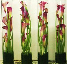 http://vasoni.net/wedding-flowers-in-tall-vases/