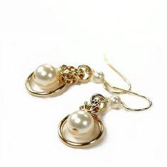 Brass earrings, Swarovski cream