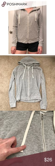 Basic Grey Sweater Sweatshirt Hooded Hoodie Zip down hoodie, juniors size so M can fit S/M and S can fit XS/S. I bought 4 of these. Keeping 2 and selling 2 of them. Tiny flaw on M shown in 2nd photo but barely visible. Brand new other than that. May or may not have the tag (I think they do both have the tag shown but if you need the tag just ask to be sure). Abound Sweaters