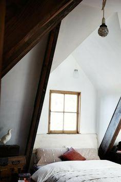 Cozy bedroom with wooden beams