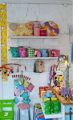 lots of shelves displaying finished items serve as inspiration while they wait to be sold/gifted.  Not afraid of color!