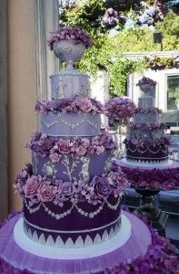 Tall purple ombre wedding cake with beautiful purple flowers