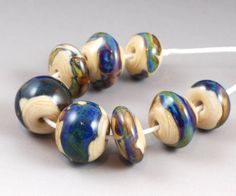 Amazonia. 8 handmade lampwork glass beads in 4 different shapes. Great as earring pair sets or for Kumihimo. Handmade by Judith Billig, $36.00