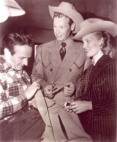 Rex Allen and his wife Bonnie check out a new Nudie suit