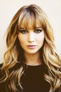 Jennifer Lawrence's long, layered & wavy hairstyle with bangs. Looks great on most facial shapes, with or without bangs.