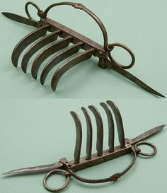 Indian (North) bagh nakh (tiger claws), 18th to 19th century, the Feldman Collection. An unusual form of bagh nakh with two folding side blades.
