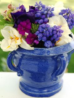 Diminutive grape hyacinth, creamy double tulips and tiny fuchsia phlox pack a powerful punch when placed in a compact handmade urn.