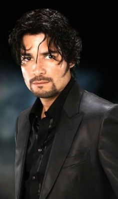 Chayanne?..so his hair is a little messy, he still looks fine!
