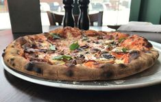 This new restaurant in Earlham is on the first floor of a newly-renovated historic building. It features a pizza oven imported from Italy that can make pies in a minute and 40 seconds. Featured: A custom pizza with mushroom, sausage and fresh basil. Electric Pizza Oven, Open Pizza, Tomatillo Salsa Recipe, Sour Cream Cake, Canadian Bacon, Pizza Restaurant, Breakfast Potatoes, Sausage Pasta, Homemade Desserts