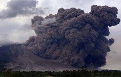 PILLARS OF SMOKE - June 25,2015 Indonesian volcano spews towering gas cloud