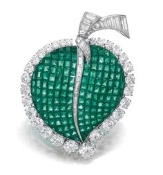 EMERALD AND DIAMOND BROOCH, VAN CLEEF & ARPELS, 1962 Designed as a leaf composed of calibré-cut emeralds en serti mysterieux, the stem and border set with circular-cut and baguette diamonds