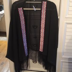 Sheer aztec cardigan with fringe detail Nwt beautiful black sheer shirt with aztec and fringe detail. Size 18/20 Cato Tops Blouses