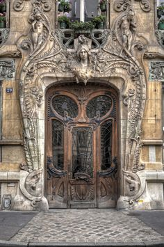 The best door in Paris - built in 1901, this Art Nouveau masterpiece is by Jules Lavirotte. 29 Avenue Rapp in the 7th arrondissement, very close to the Eiffel Tower, Paris, France