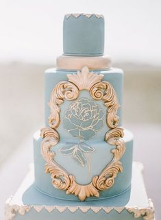 shade of blue wedding cake/ royal gold and dusty blue wedding cake