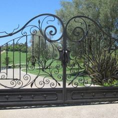 Beautiful wrought iron gate by #GATE4LESS, perfect for your driveway gate! More at: http://www.pinterest.com/avivbeber3/iron-garage-doors-gates-fence/