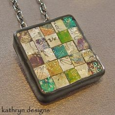 This striking mosaic necklace was handcrafted with liquid polymer clay veneers that I reassembled into a stunning mosaic pattern. MEMBER - KathrynDesigns