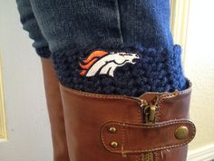 Hand-crocheted Denver Bronco Boot Cuffs.  The perfect accessory to your outfit in support of the Denver Broncos! Made with 100% acrylic yarn.