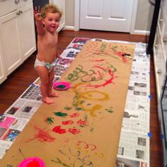 My daughter painting wrapping paper for the family