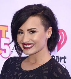 Pin for Later: Every Hair Color and Cut Demi Lovato Has Ever Had A Chocolate Bob With a Buzzed Side The holiday season brought back a more traditional look for Demi — if you can call a shaved side traditional.