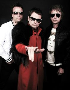 Muse - Bellamy looks like he as a vulture on his shoulder