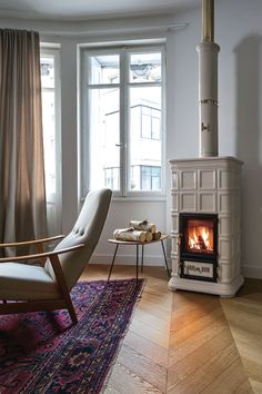 Energy-efficient wood-burning heating system for the contemporary home Freestanding Stoves Stove & 360 best Modern Heating Systems images on Pinterest | Heating ...
