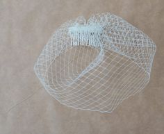 DIY-Birdcage-Veil-6---birdcage-before-lace. Read More - http://onefabday.com/diy-birdcage-veil/