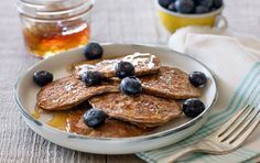 Mashed banana, eggs and cinnamon make for tender, rich grain-free pancakes. Drizzle with maple syrup, honey or yogurt, or scatter fresh fruit over the top. For variety, stir healthful additions into the batter: try flaxseeds, nuts, chia or hemp seeds, a spoonful of almond butter, or spices like grated nutmeg or ground ginger. Simply eaten out of hand, these pancakes are an easy portable snack for kids and adults, too.