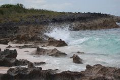 Waves breaking from the Atlantic Ocean on volcanic rock at Guana Cay, Abaco, Bahamas