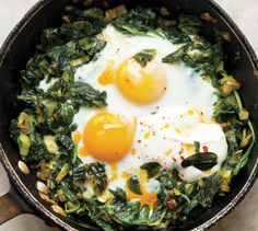 """American and British cooks don't know how far you can take an egg dish,"" chef Yotam Ottolenghi says. Here, he deftly elevates it to a different realm by flavoring spinach with melted leeks and scallions, baking eggs on top, and finishing with a dollop of yogurt and a drizzle of butter spiced with a smoky Turkish chili powder known as kirmizi biber (though crushed red pepper flakes will also work). Serve the dish in one large skillet or two small ones. ""It's always nice to surprise people,""…"