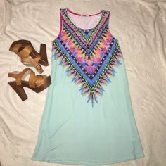 """Aqua/tribal print dress This dress is so pretty! Aqua color base with """"tribal"""" print pattern around the top. Never been worn - size small! This would go great with a pair of nude heels or wedges and also with the turquoise and gold necklace in my closet! Bundle these items to save money! Selling for ✨$25✨ will ship same or next day! Dresses Mini"""