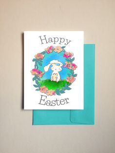 This Easter card features a cute Easter bunny illustration by Amber and on the inside says: Wishing you a very Happy Easter that is filled with plenty of love and happiness.  - A2 size (4.25 x 5.5) - Professionally printed in onto heavyweight matte stock - Comes with your choice of colored envelope  This listing is for one card. The card and envelope are protected with a clear sleeve, then mailed within 2 business days of purchase.  ***HOLIDAY CARDS: TYPICALLY DELIVERED TO YOU IN 4 BUSINESS…