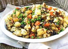 Roasted Vegetables from the Spice Islands | Carrots, potatoes, eggplant and cauliflower, roasted then briefly stewed with peas and exotic African spices.