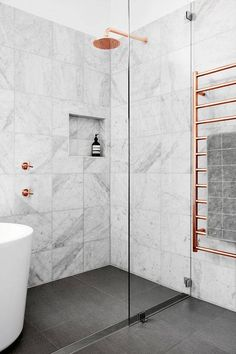 Copper and marble bathroom