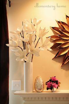 @Elle @ Ellementary Home fills vase of magnolia blossoms on her spring mantle.