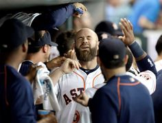 Seed shower -        Houston Astros' Evan Gattis has sunflower seeds dumped on his head after hitting a two-run home run against the Toronto Blue Jays May 16 in Houston. Houston won 6-3.  - © Pat Sullivan/AP