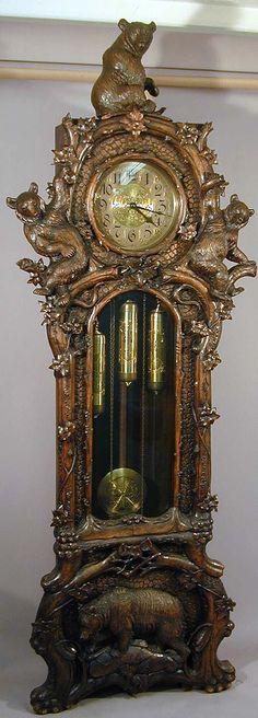 a fantastic carved bear grandfather clock, swiss ca. 1900.
