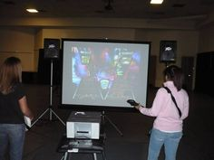 goldfish racing DDR Wii games large screen Island Hair Guitar Hero Rock Band Arcade games grad party all night michigan